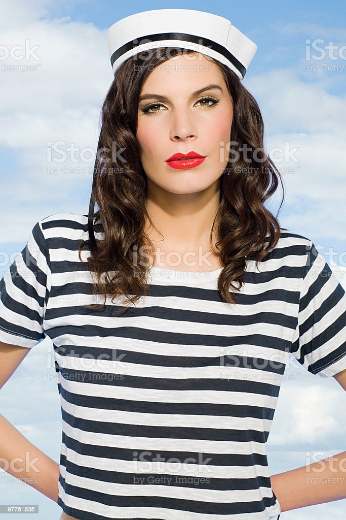 Young woman in sailor hat stock photo