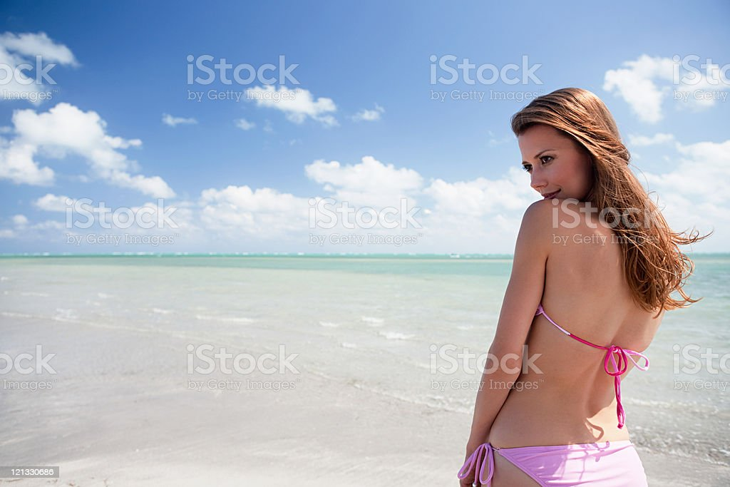 Young woman in sea looking away, portrait stock photo