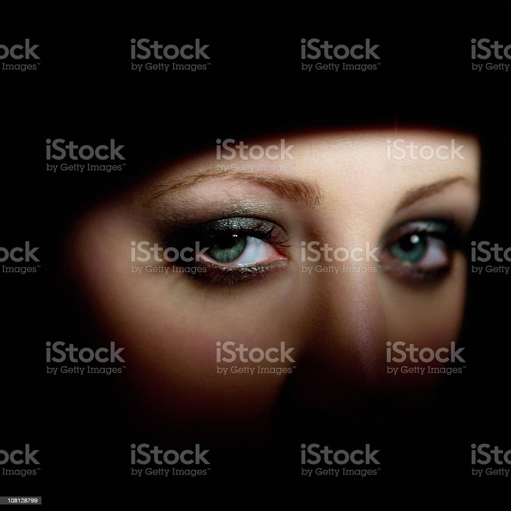 Young Woman in Shadows stock photo