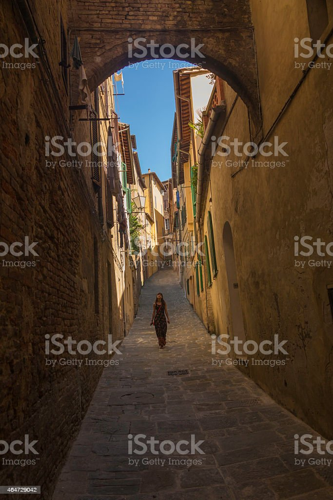 Young woman in Siena street. stock photo