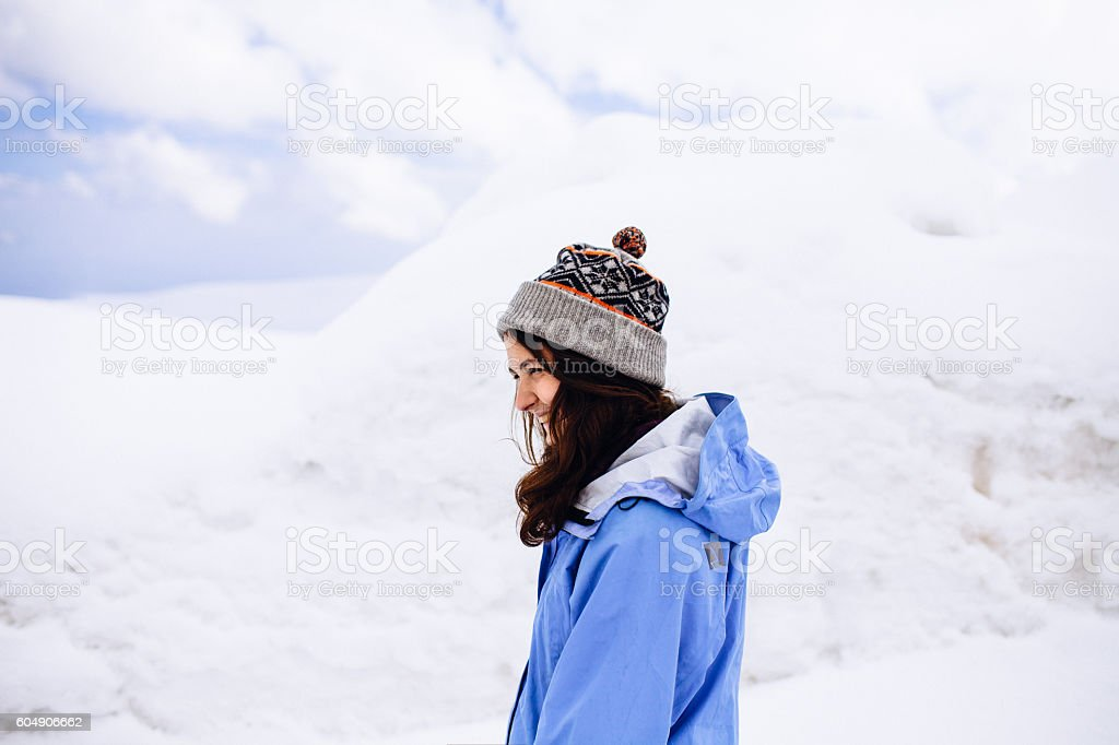 Young woman in snow stock photo