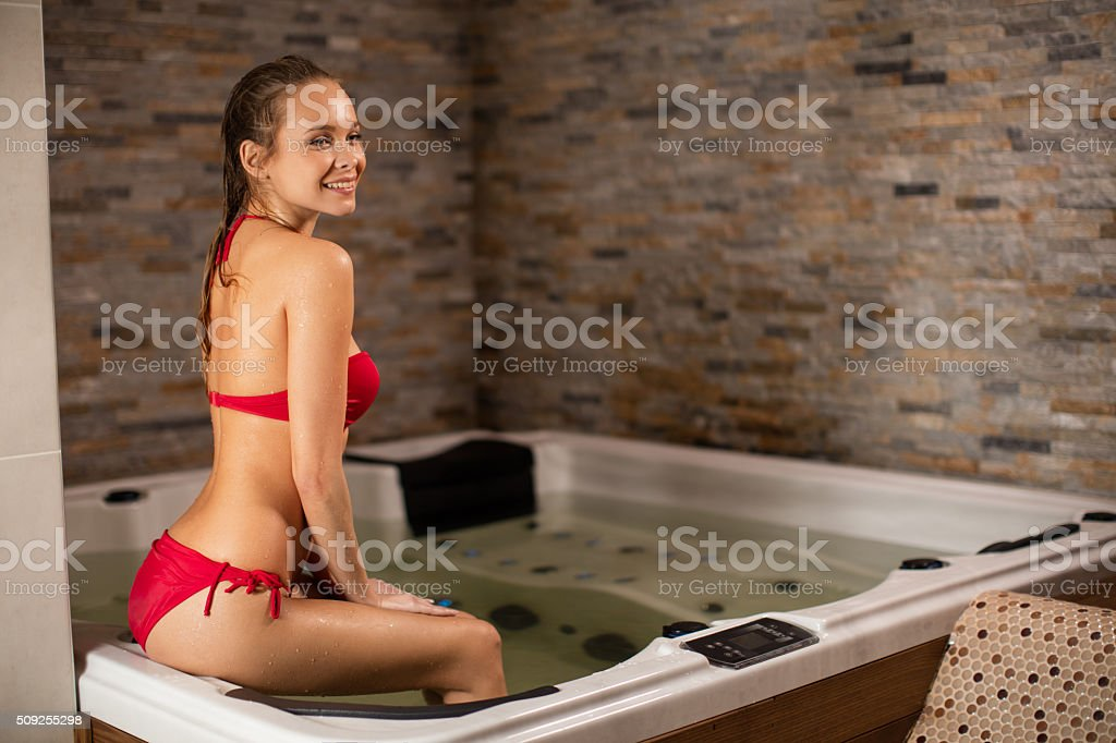 Young woman in spa bath stock photo