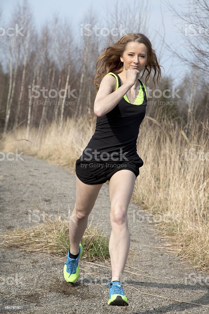 Young woman in sport dress running royalty-free stock photo