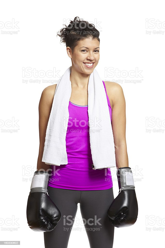 Young woman in sports outfit wearing boxing gloves royalty-free stock photo