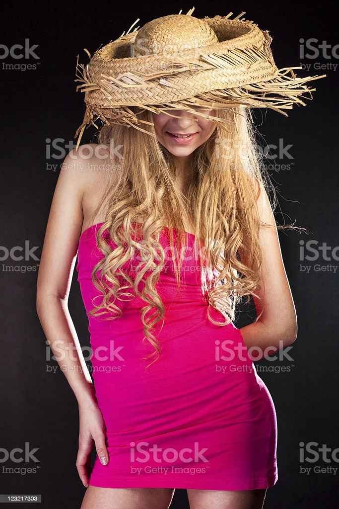 Young woman in straw hat stock photo