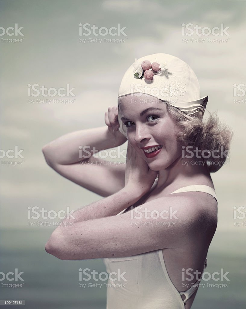 Young woman in swimming costume, smiling, portrait stock photo