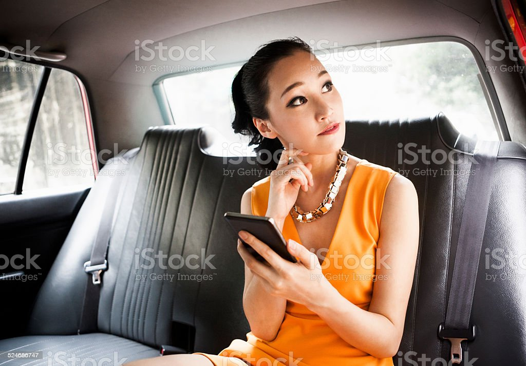Young Woman in Taxi stock photo