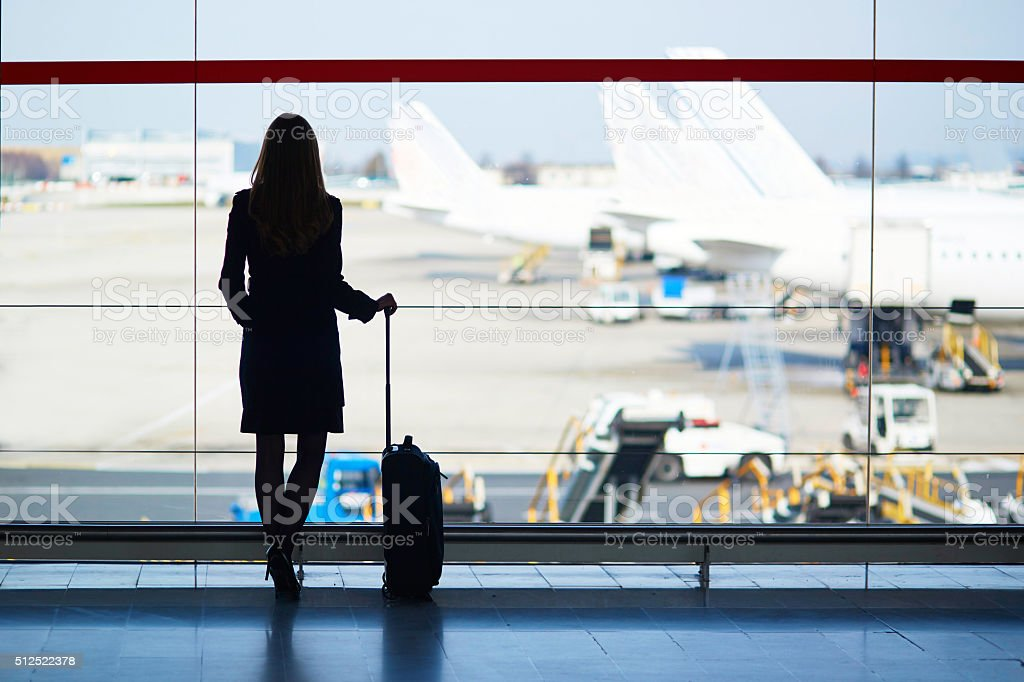 Young woman in the airport stock photo