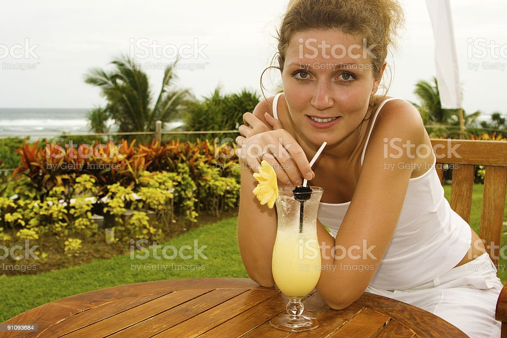 Young woman in the bar on Bali beach royalty-free stock photo