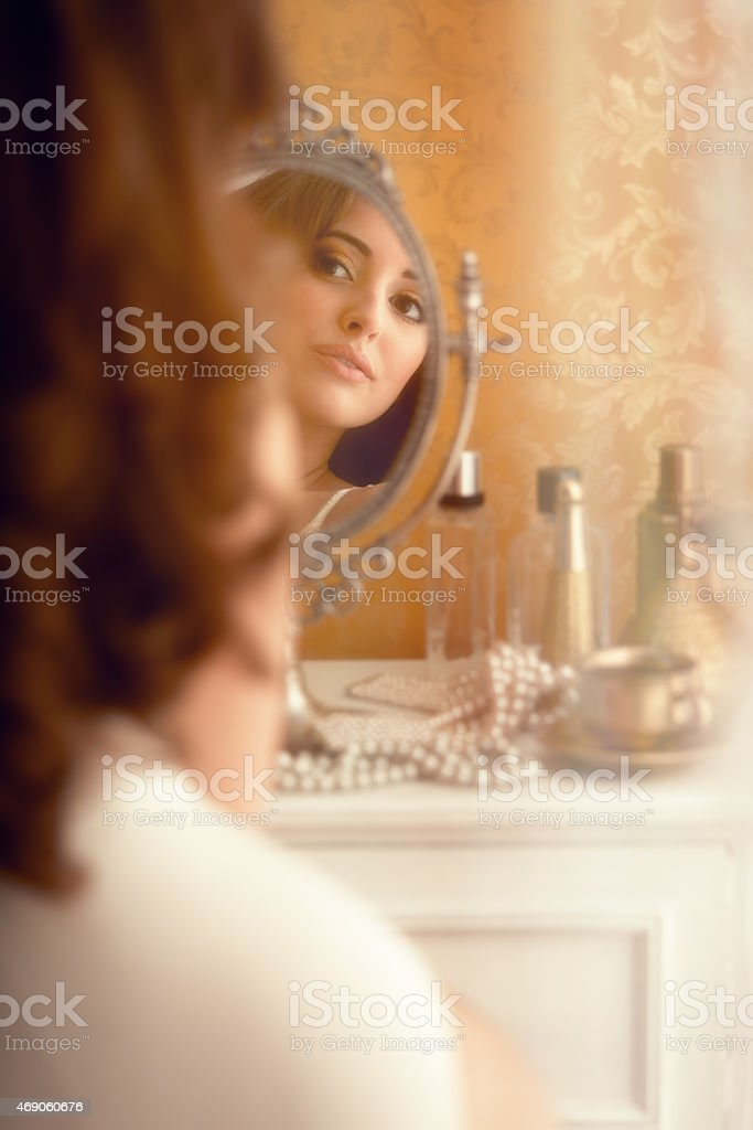 young woman in the boudoir - glamour photo stock photo