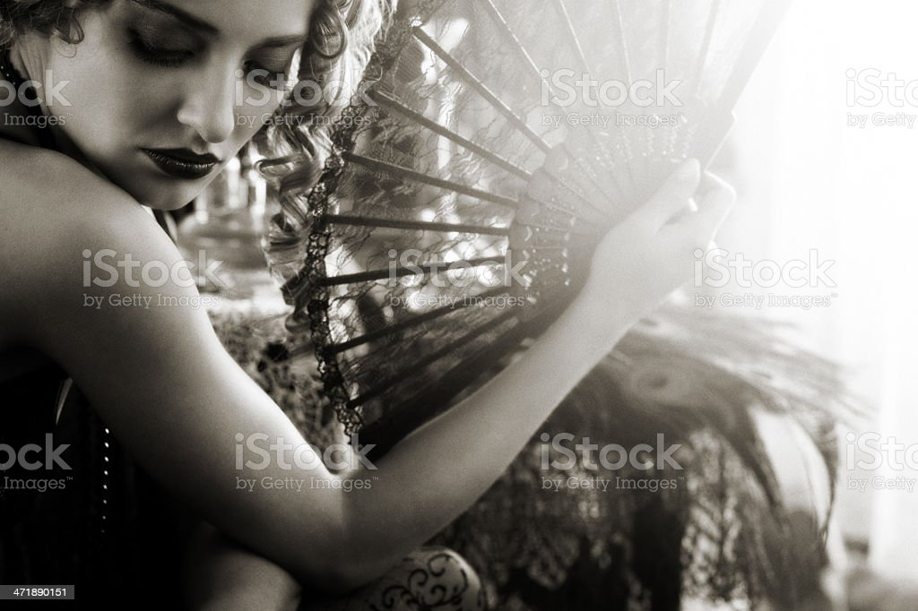 young woman in the boudoir with lace fan stock photo