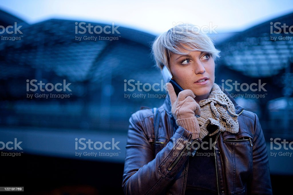 Young Woman In The City At Dusk stock photo