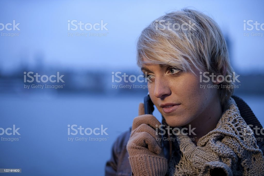 Young Woman In The City At Dusk royalty-free stock photo