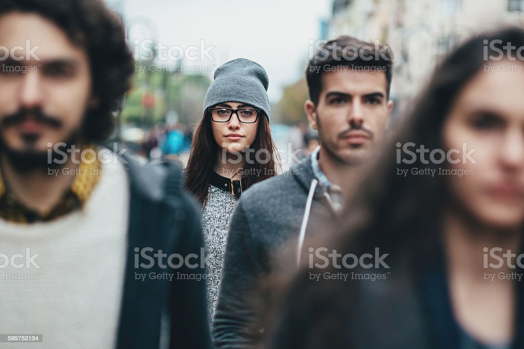 Young woman in the crowd stock photo