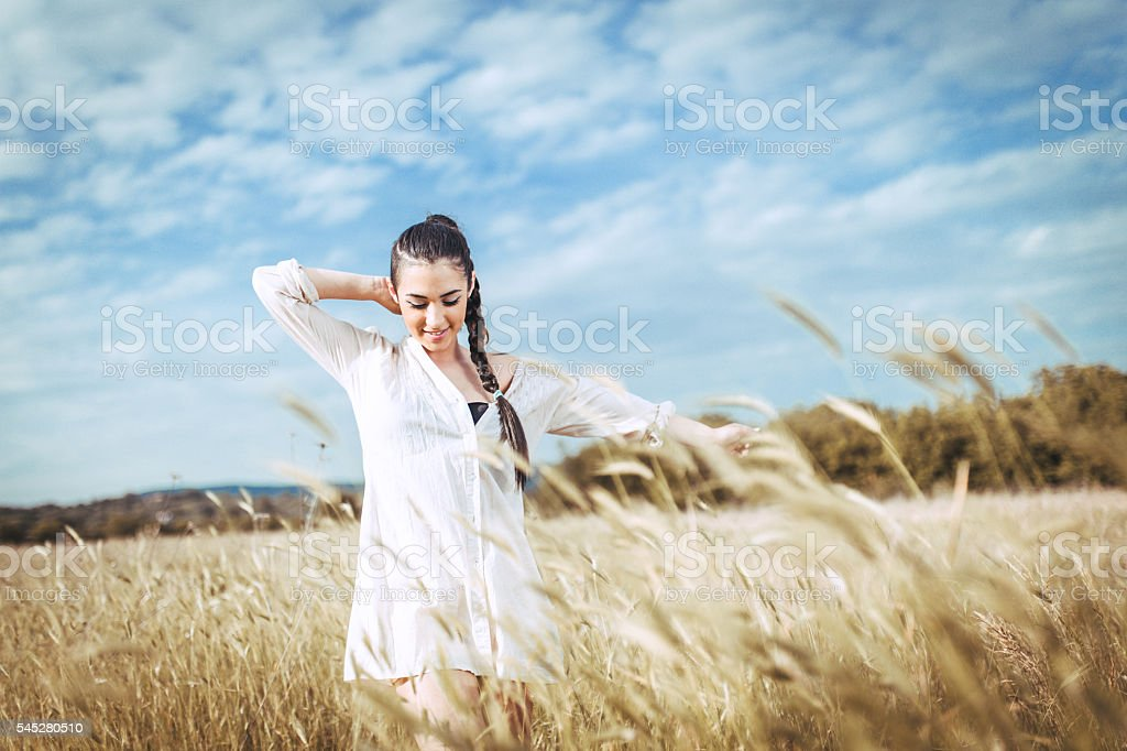 young woman in the field stock photo