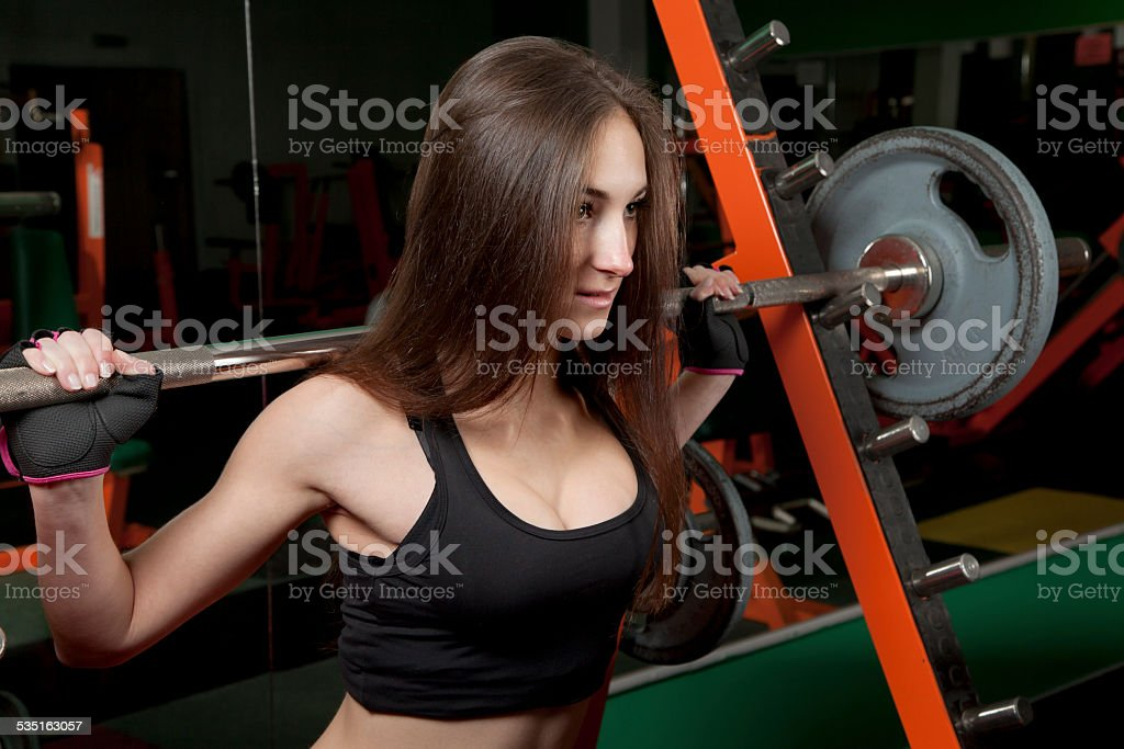 Young woman in the fitness center stock photo