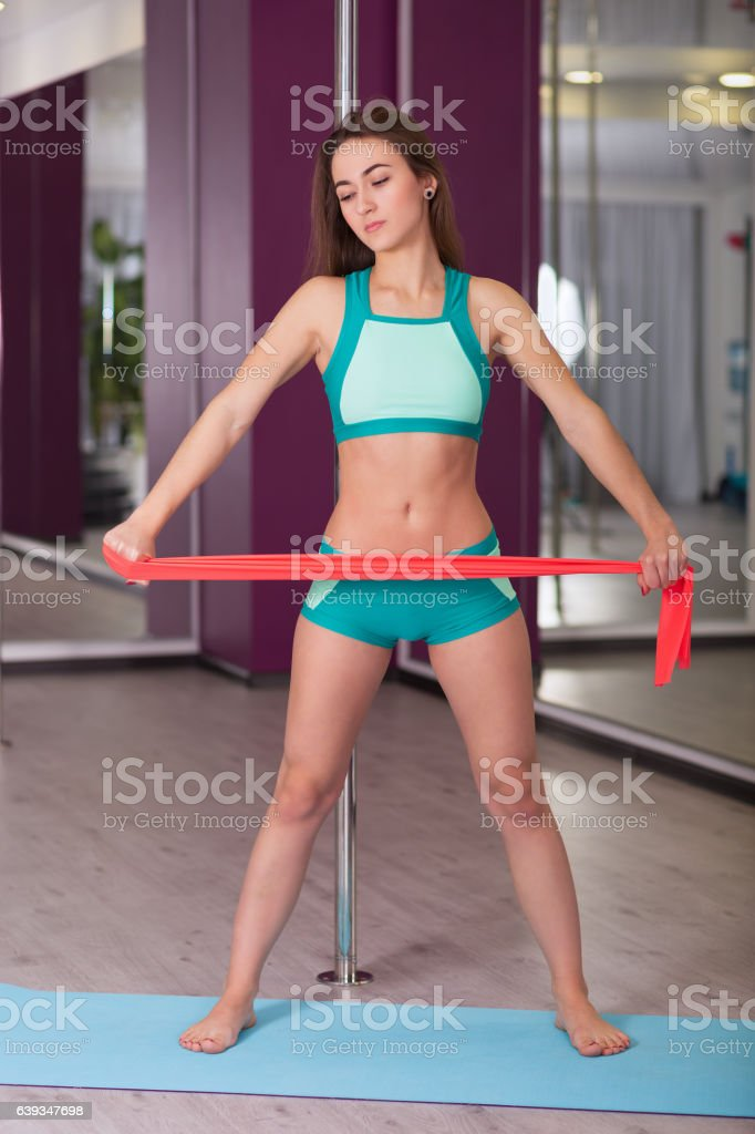 Young woman in the fitness studio stock photo