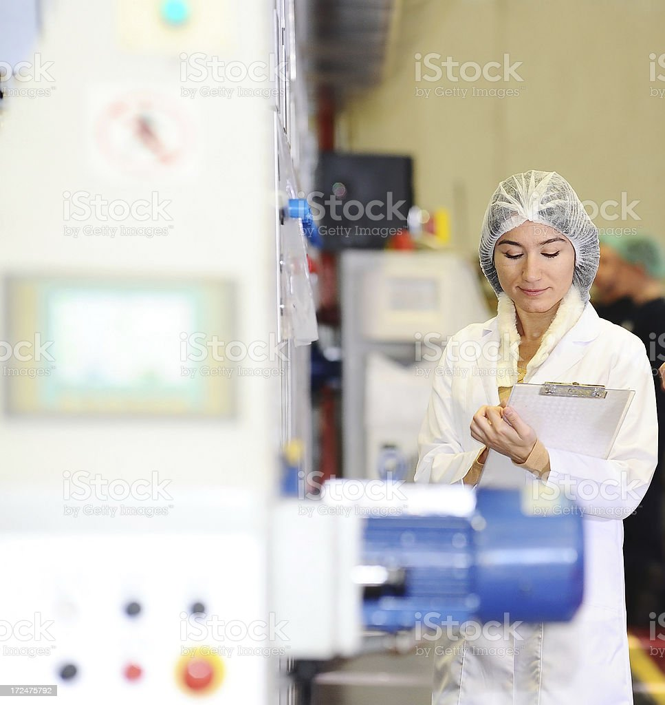 Young woman in the food processing plant stock photo