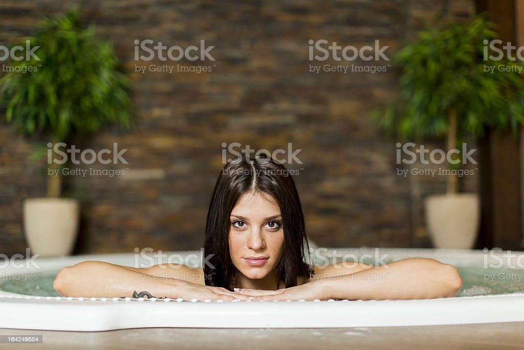 Young woman in the hot tub royalty-free stock photo