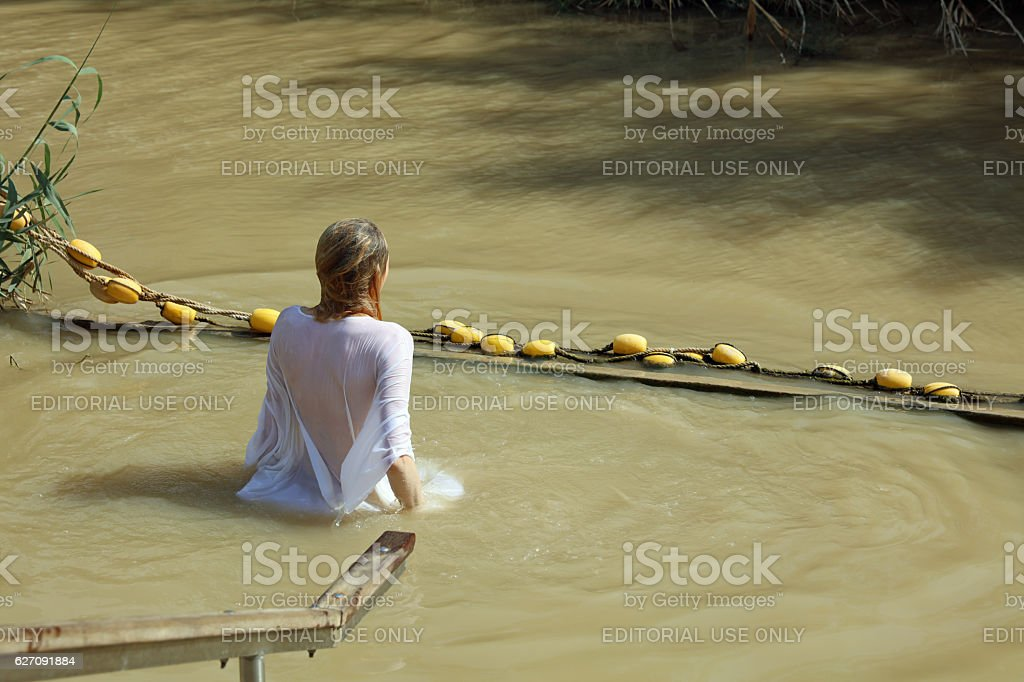 Young Woman in the Jordan River stock photo