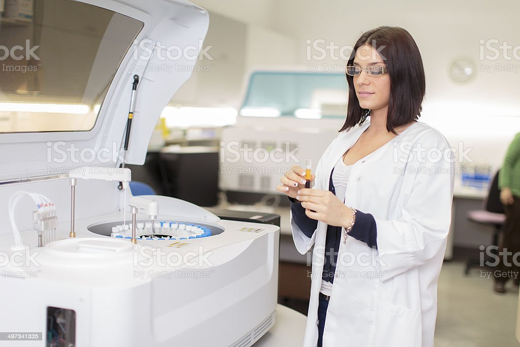Young woman in the medical laboratory stock photo