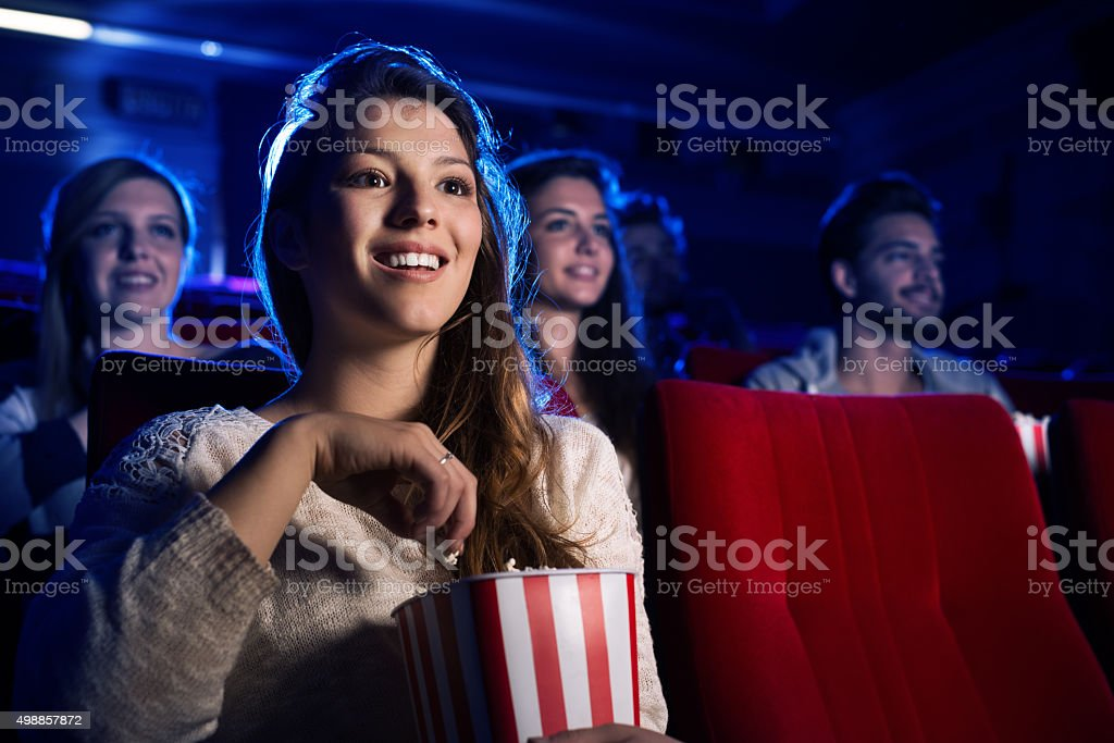 Young woman in the movie theater stock photo