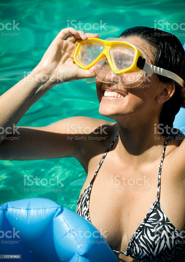 Young Woman in the Ocean with Snorkeling Goggles royalty-free stock photo