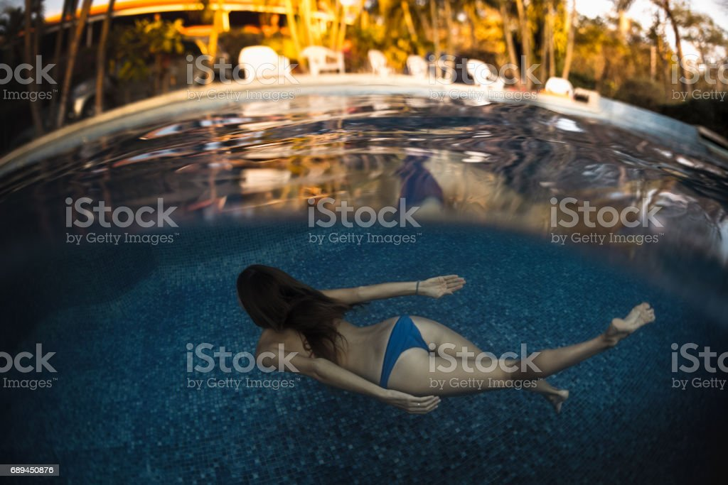 Young woman in the pool stock photo