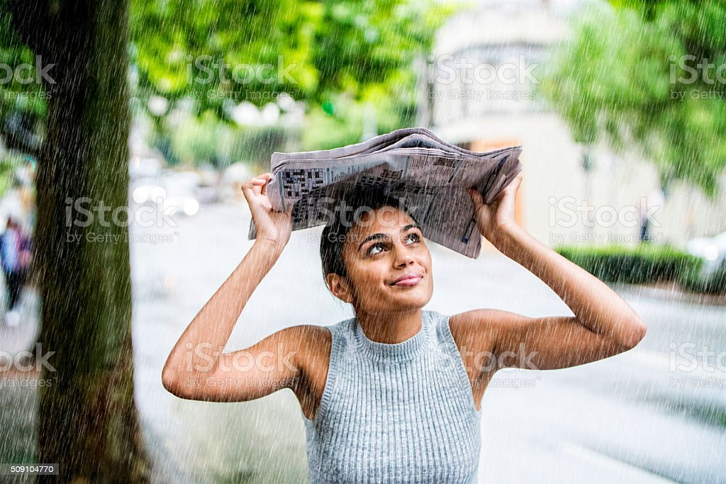 Young woman in the rain. stock photo