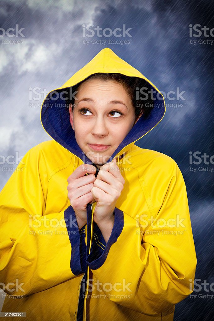Young woman in the rain stock photo