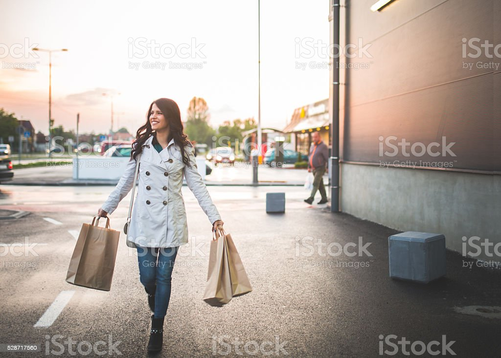 Young woman in the shopping stock photo