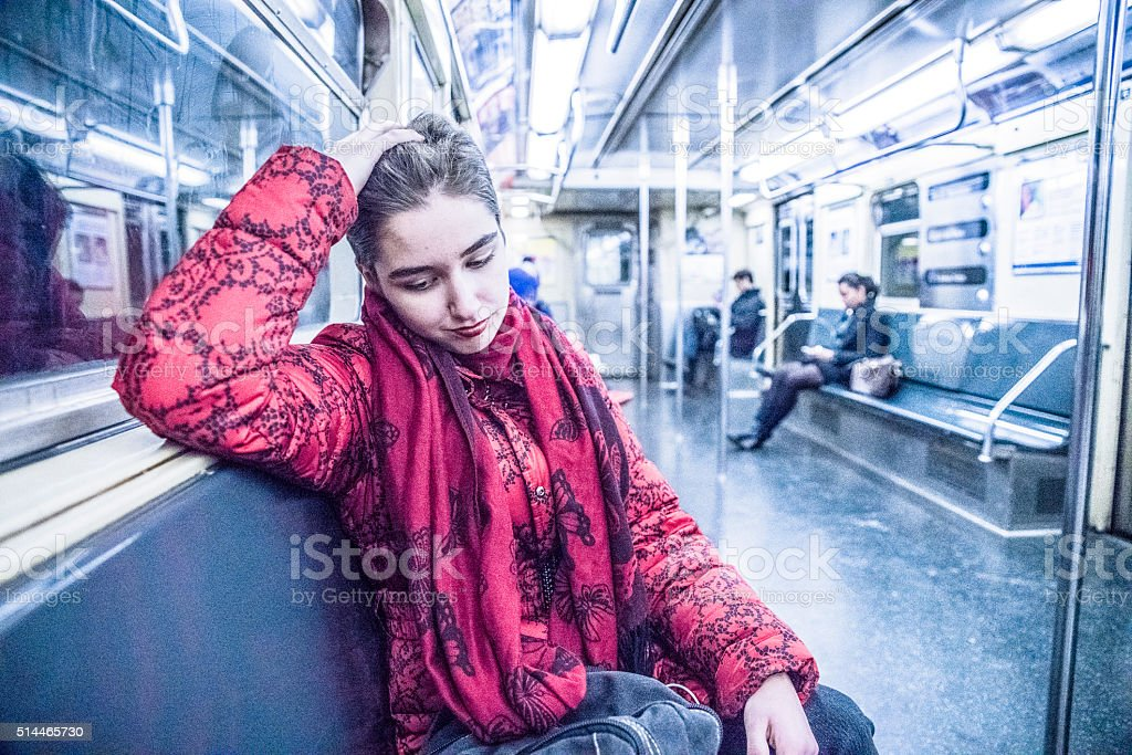 Young woman in the subway car in New York City stock photo