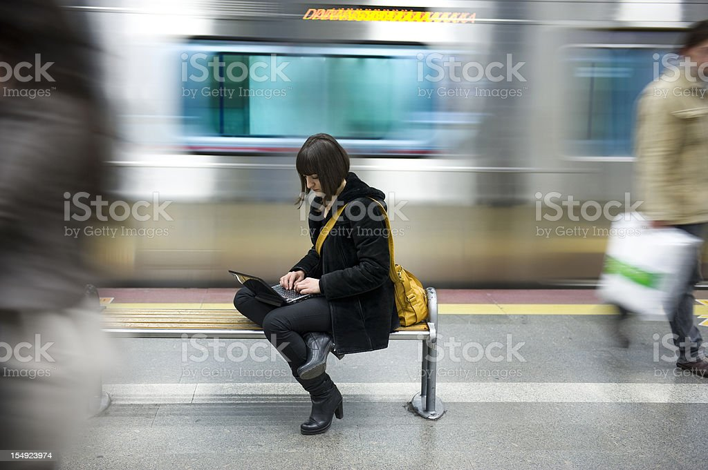 Young woman in the subway station stock photo