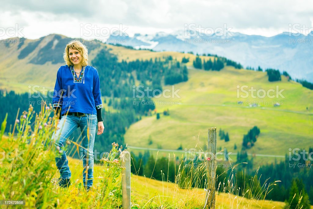 young woman in the swiss alps royalty-free stock photo