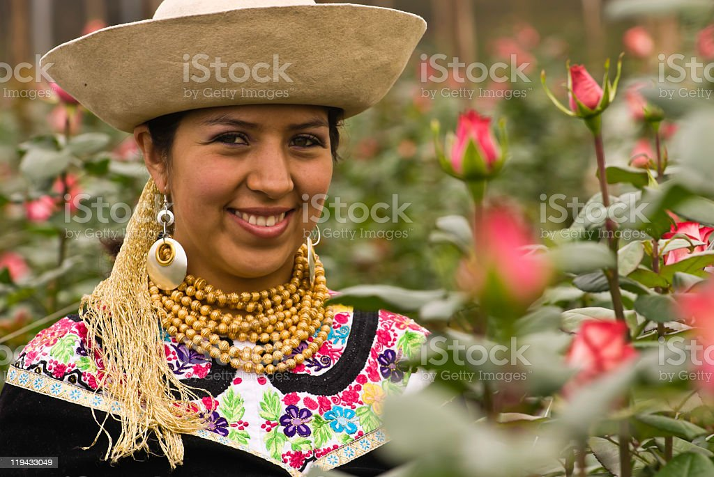 Young woman in traditional Ecuadorian dress with roses stock photo