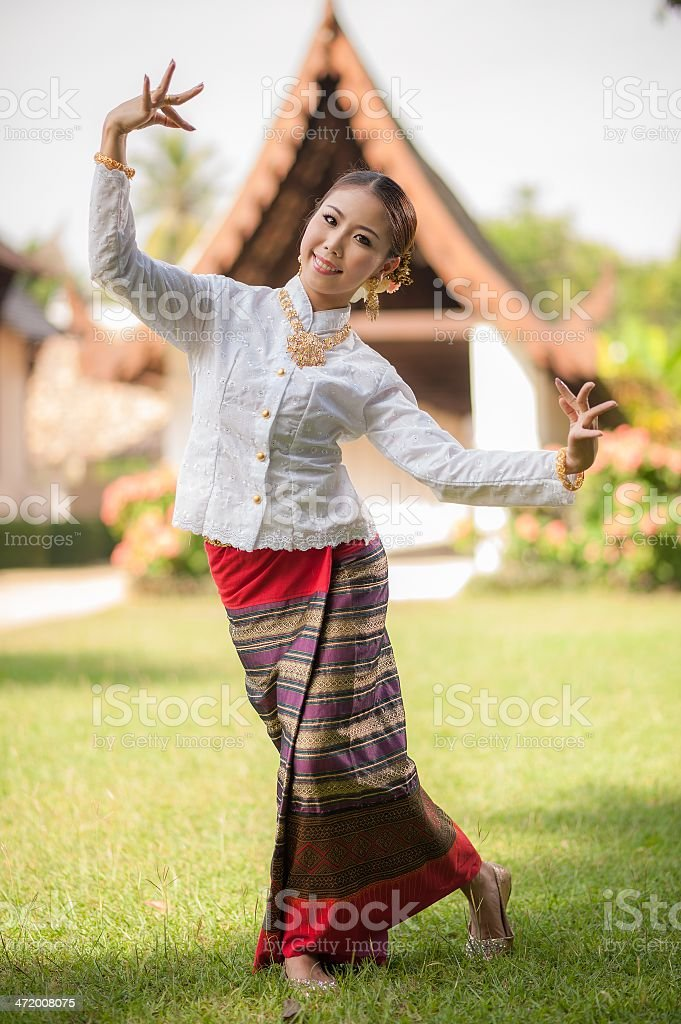 Young woman in traditional garb performing a cultural dance stock photo