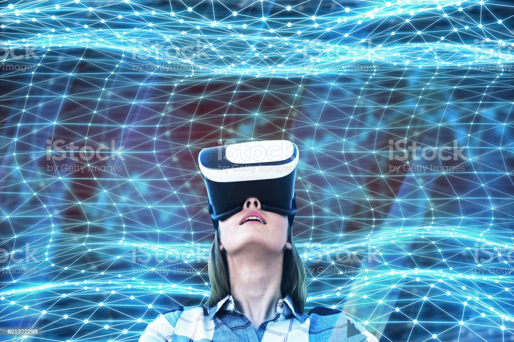Young woman in VR glasses stock photo