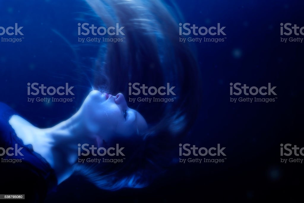 Young woman in water stock photo