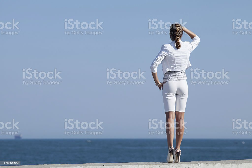 Young woman in white at the sea royalty-free stock photo