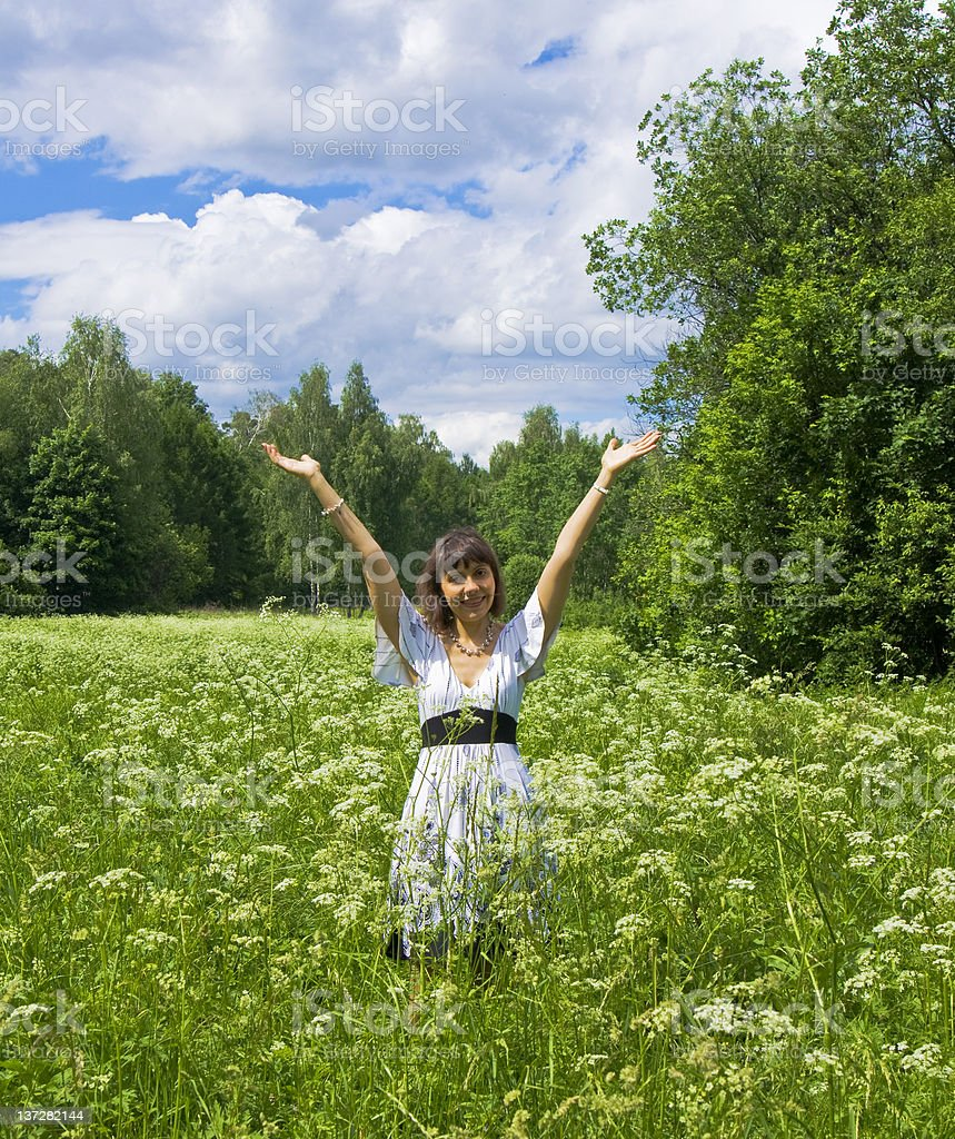 Young woman in white dress on meadow with flowers royalty-free stock photo