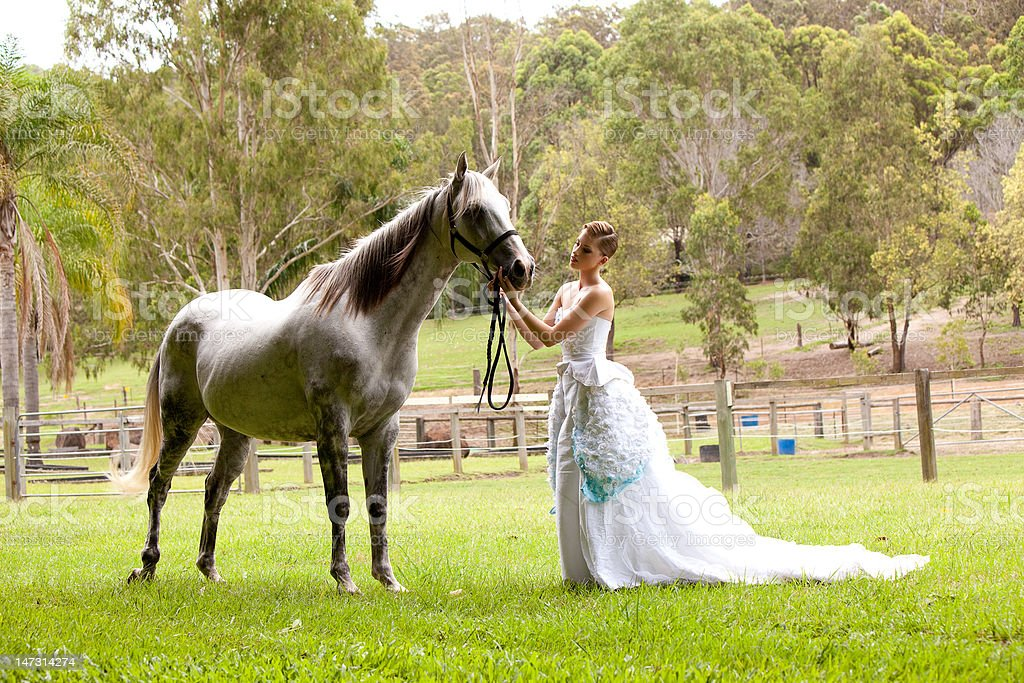 Young Woman in White Dress Outdoors With Horse royalty-free stock photo