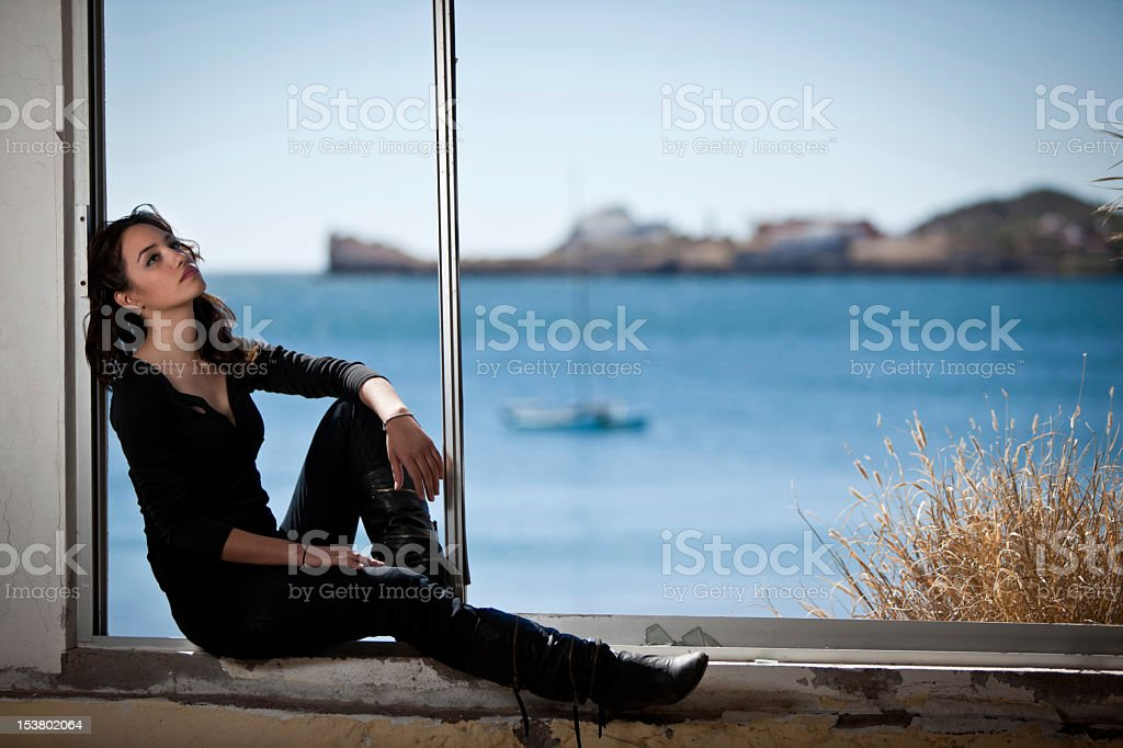Young Woman in Window royalty-free stock photo