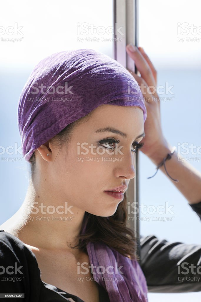 Young Woman in Window with Purple Scarf royalty-free stock photo