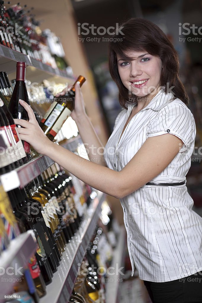 Young woman in wine shop royalty-free stock photo