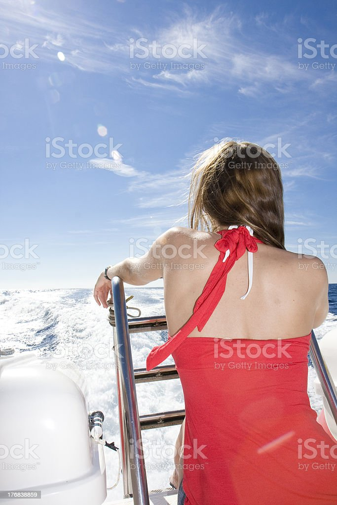 Young woman in yacht stock photo