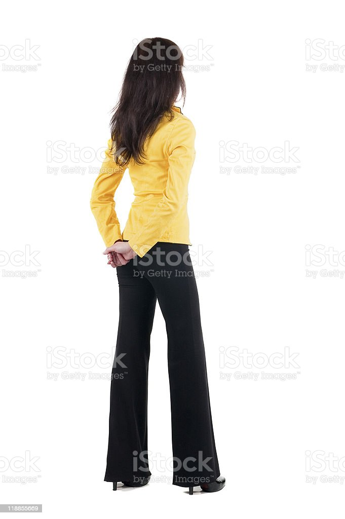 Young woman in yellow suit looking at wall royalty-free stock photo