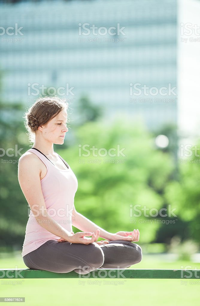 Young woman in yoga pose stock photo