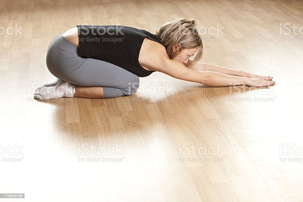 Young woman in yoga position royalty-free stock photo