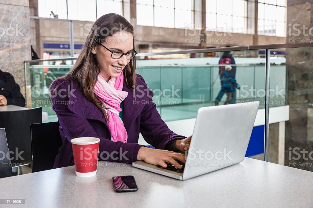 Young Woman inside Train Station or Airport royalty-free stock photo