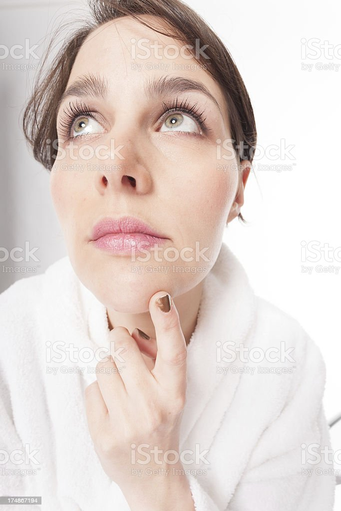 Young woman inspecting her skin royalty-free stock photo